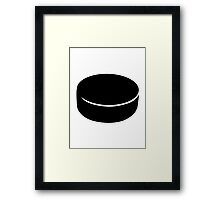 Hockey puck Framed Print