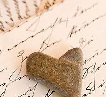 Stone heart and writing by artsandsoul