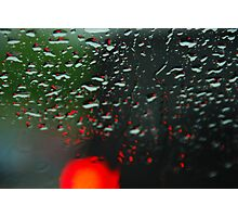 Brake lights through rain drops Photographic Print