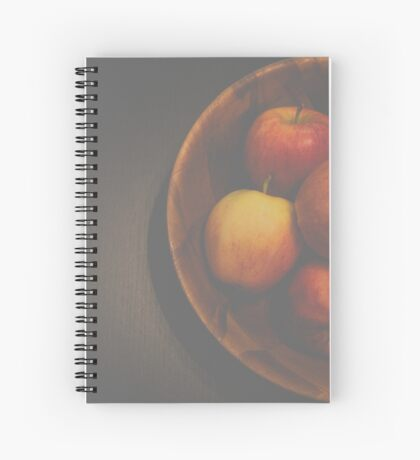 apple in wooden bowl Spiral Notebook