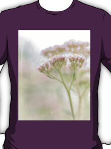 Delicate pink flower on multiple stems emerge from vintage parchment paper. T-Shirt