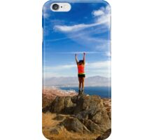 Female hiker celebrates her achievement on reaching the summit of the colourful Eilat mountains iPhone Case/Skin