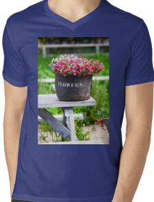 pot of flowers on a weathered wooden table  Mens V-Neck T-Shirt