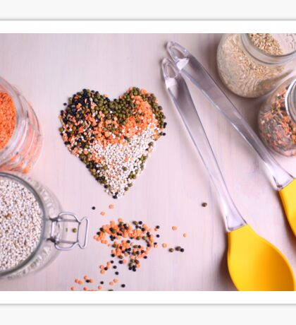 Red white, and black lentils forming a valentine heart shape for healthy living  Sticker