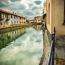 Italian canal with houses by Silvia Ganora