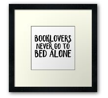 Booklovers never go to bed alone Framed Print