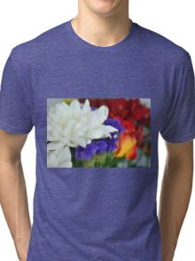 Watercolor style natural background with beautiful colorful flower petals and leaves. Tri-blend T-Shirt