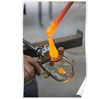 Glassblower cuts molten glass with a hand tool Poster