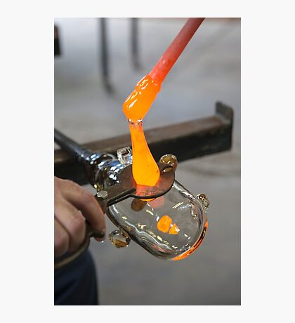 Glassblower cuts molten glass with a hand tool Photographic Print