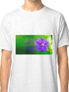 Digitally manipulated purple garden flower with lush green background  Classic T-Shirt