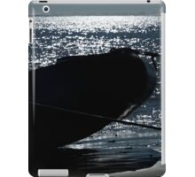 Silhouette of inflatable and paddle on beach iPad Case/Skin
