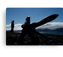 Silhouette of anchor with rifleman on beach Canvas Print