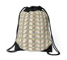 Four Heads in Green Drawstring Bag