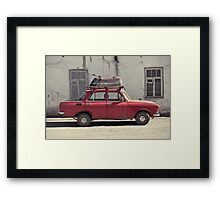 A car with a bathtube Framed Print