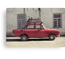 A car with a bathtube Canvas Print