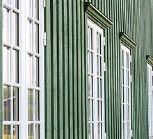 White wooden windows and green walls - traditional architecture in Norway by Stanciuc