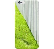 White fence and fresh green grass close-up iPhone Case/Skin