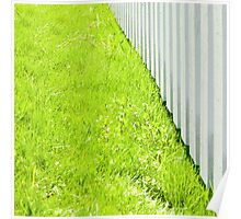 White fence and fresh green grass close-up Poster