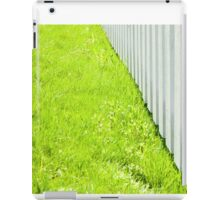 White fence and fresh green grass close-up iPad Case/Skin