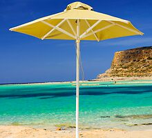 Tropical vacation - beds and umbrella on a beach by Stanciuc