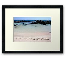 NOT IN THE OFFICE written on sand on a beautiful beach, blue waves in background Framed Print