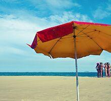 Girls on beach by Andreas Schjønhaug