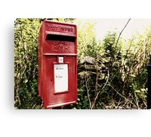 Vintage red postbox in the countryside Canvas Print