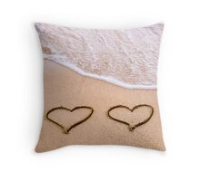 Two hearts drawn in the sand on a beautiful beach Throw Pillow