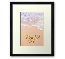 Two hearts and email sign drawn in the sand on a beautiful beach  Framed Print