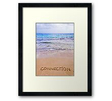 Connection word written on sand, with waves in background Framed Print