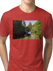 The Crooked Cypress - Elegantly Bowed Tree, Curving Over a Crystal Clear River Tri-blend T-Shirt