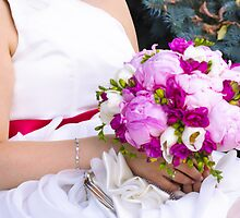Bride with bouquet, close-up by Stanciuc