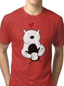 A polar bear and a penguin are real friends Tri-blend T-Shirt