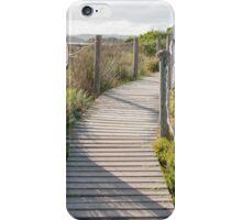 Wooden path crossing grass field in summer iPhone Case/Skin