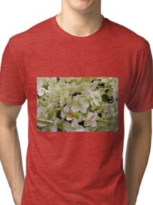 Natural background with small green leaves and flowers. Tri-blend T-Shirt