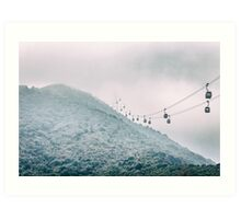 Cable car on a misty mountain high up Art Print