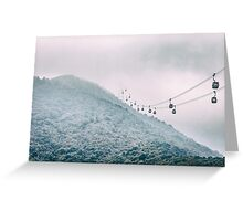 Cable car on a misty mountain high up Greeting Card
