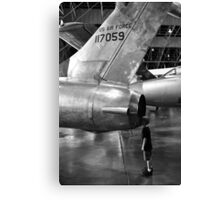 Boy looking into jet airplane thruster black and white Canvas Print