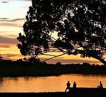 The sunset glows on Puerto Narino, Amazon River by lunaencantada