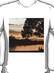 The sunset glows on Puerto Narino, Amazon River T-Shirt