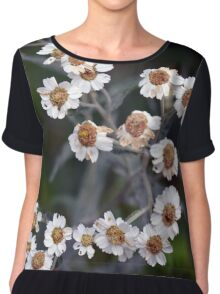 Small white flowers in the garden. Chiffon Top