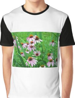 Delicate pink flowers in the grass. Graphic T-Shirt