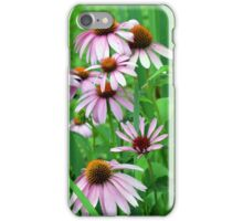 Delicate pink flowers in the grass. iPhone Case/Skin