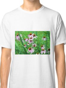 Delicate pink flowers in the grass. Classic T-Shirt
