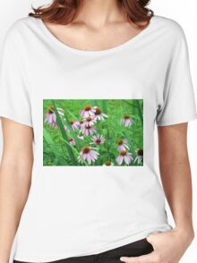 Delicate pink flowers in the grass. Women's Relaxed Fit T-Shirt