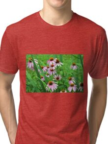 Delicate pink flowers in the grass. Tri-blend T-Shirt