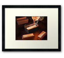 Gold ingot casting Framed Print