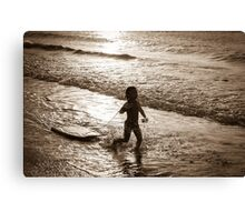 Little surfer girl runs in the waves Canvas Print