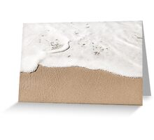 Wave gently washes up on a sandy beach Greeting Card