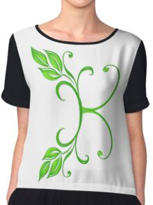 A letter K formed with leaves. Chiffon Top